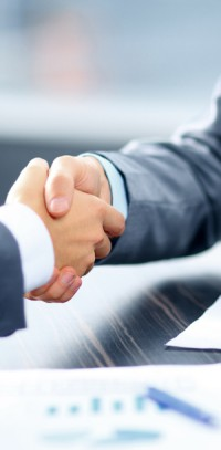 Businessmen shaking hands. McCanliss & Early securities arbitration practice.