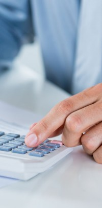 Hand at keyboard. McCanliss & Early taxation practice.